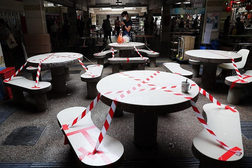 Tables and chairs cordoned off at Clementi Market and Food Centre last Saturday due to the ban on dining in at eateries. By spreading out the relaxing of rules, it will be easier to quickly tighten measures again to stop a surge should the number of