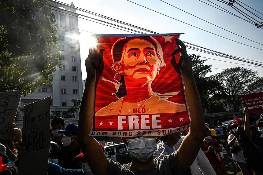 Protesters at a demonstration in February against the military coup in Yangon. The army overthrew Ms Aung San Suu Kyi, the elected leader, saying her party had cheated in November elections, an accusation rejected by the previous election commission