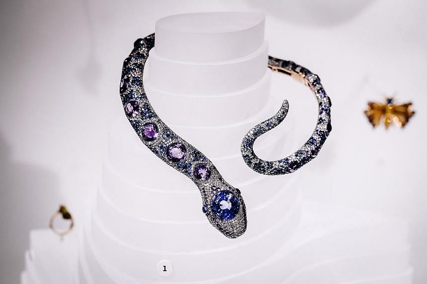 A snake necklace (above) by Cartier Paris from 1968 and a pelican cuff (left) by Bina Goenka from 2009 at the Beautiful Creatures exhibition. Sea animal-themed jewellery (left) is part of a special exhibition at the American Museum of Natural History