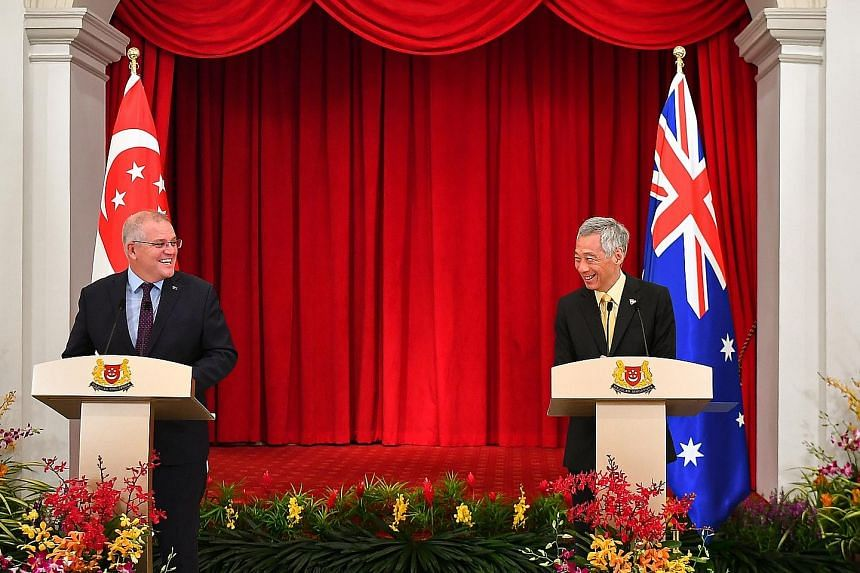 Prime Minister Lee Hsien Loong and Australian Prime Minister Scott Morrison at a joint news conference at the Istana after their meeting yesterday. PM Lee said the two leaders discussed the fight against Covid-19 and resuming travel between their cou