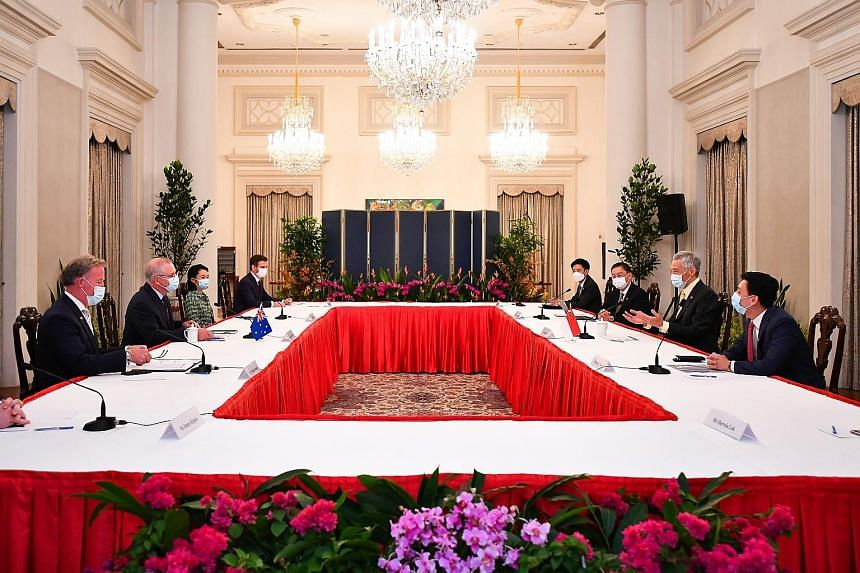 Prime Minister Lee Hsien Loong speaking with Australian Prime Minister Scott Morrison (second from left) at the sixth Australia-Singapore Annual Leaders' Meeting at the Istana yesterday. With them were (from left) Mr William Hodgman, Australia's High