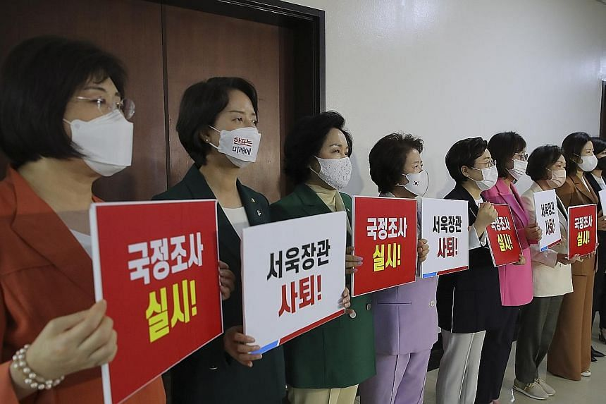 Female lawmakers of the main opposition People Power Party gathered in front of the National Assembly's defence committee in Seoul on Wednesday to call for a parliamentary probe and the resignation of the Defence Minister over the death of an air for
