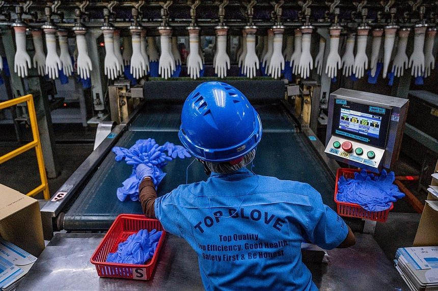 A worker in a Top Glove factory in Shah Alam, Malaysia, last year. The firm's strong third-quarter performance was mainly due to technological advancements and research and development, it noted in a filing.