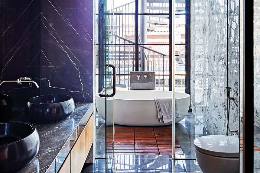 Floor-to-ceiling glass gives the master bathroom an outdoorsy feel.