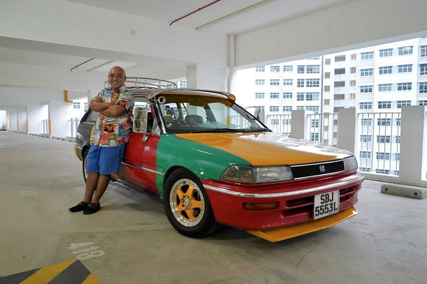 Mr Jasni Arsat had to first convince his wife to allow him to paint his car in rainbow colours, but added that it did not take long for her to agree.