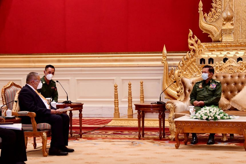 (From left) Brunei's Second Minister of Foreign Affairs Erywan Yusof speaks with Myanmar military chief senior general Min Aung Hlaing during their meeting at the presidential house in Myanmar on June 4, 2021.