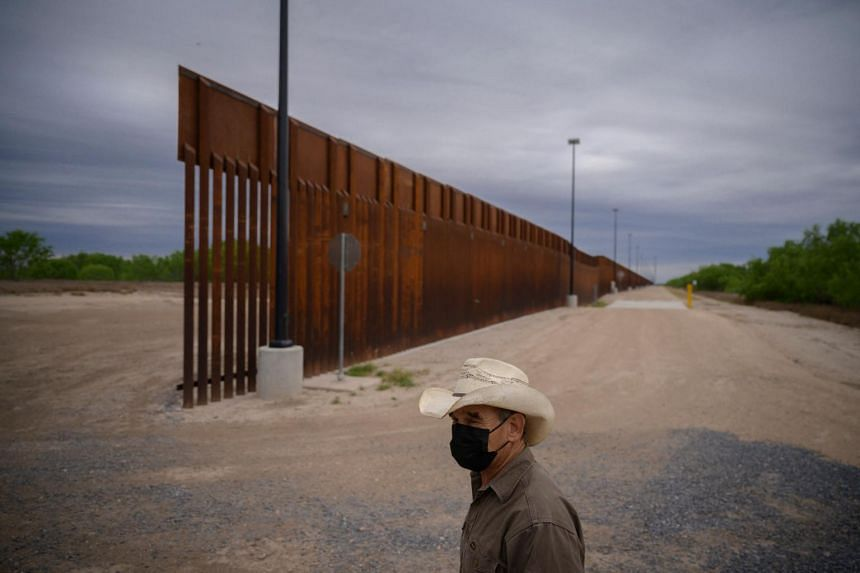 A portion of the unfinished border wall that former US president Donald Trump tried to build, near the Texas city of Roma, on March 28, 2021.