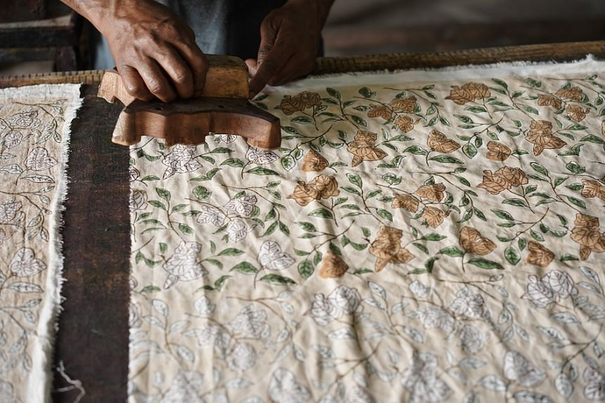 Sui founder Mahima Gujral works with  artisans in India  to make printed  fabric using  traditional  block-printing  techniques (above) and  embroider  designs on  clothing.