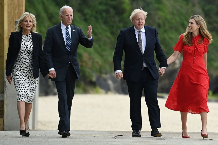 Britain's Prime Minister Boris Johnson (second from right) and his wife Carrie Johnson walk with US President Joe Biden and US First Lady Jill Biden in Carbis Bay, Cornwall.