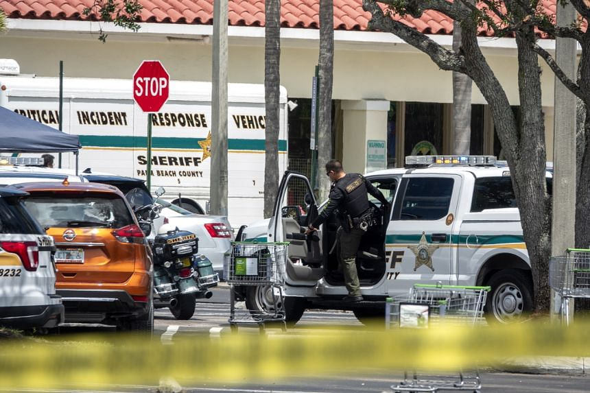 Police officers are seen at the scene of a shooting at a Publix supermarket in Royal Palm Beach, Florida, on June 10, 2021.