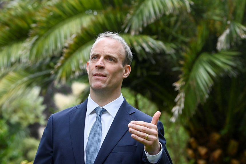 Britain's Foreign Secretary Dominic Raab speaks on the sidelines of the G-7 summit in Cornwall, Britain, on June 11, 2021.