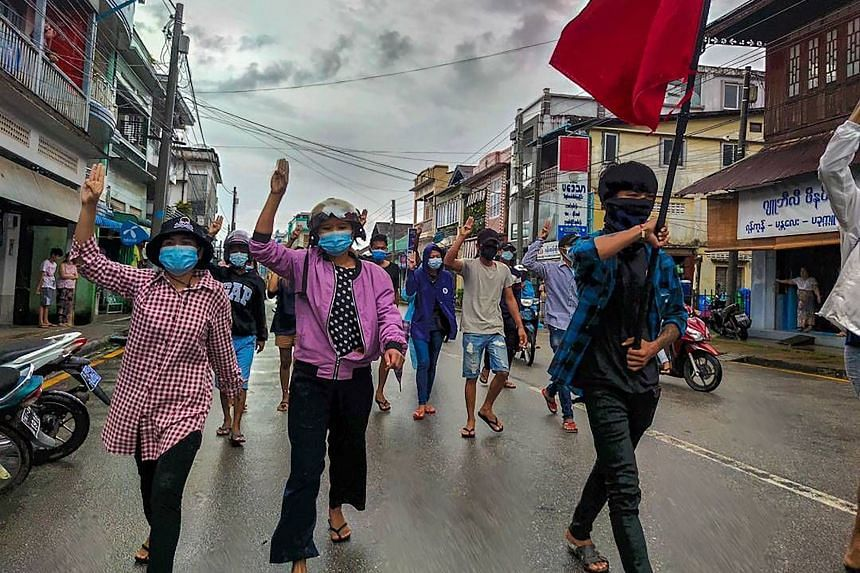 Protesters holding up the three-finger salute during a demonstration against the military coup in Dawei, Myanmar, on June 10, 2021.