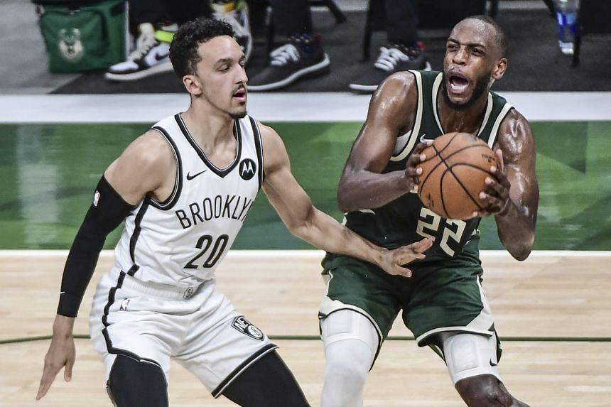Milwaukee Bucks forward Khris Middleton (right) driving for the basket during the NBA match, on June 10, 2021.