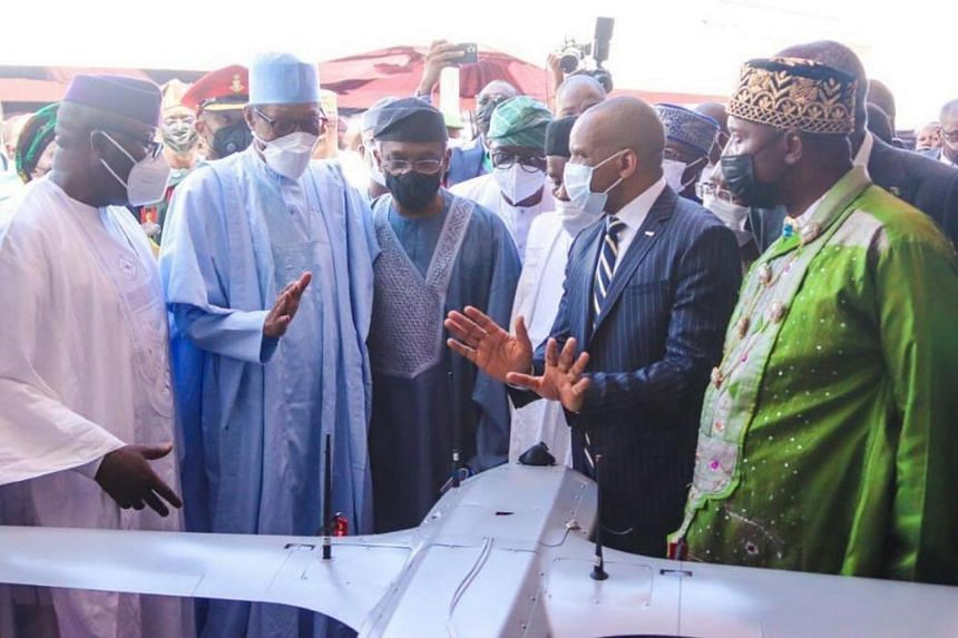Nigerian President Muhammadu Buhari (second from left) at the launch of Project Deep Blue in Lagos, Nigeria, on June 11, 2021.
