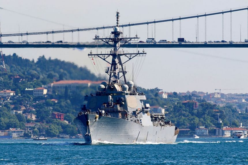 The US Navy guided-missile destroyer USS Laboon sets sail in the Bosphorus, on its way to the Black Sea, in Istanbul, Turkey, on June 11, 2021.