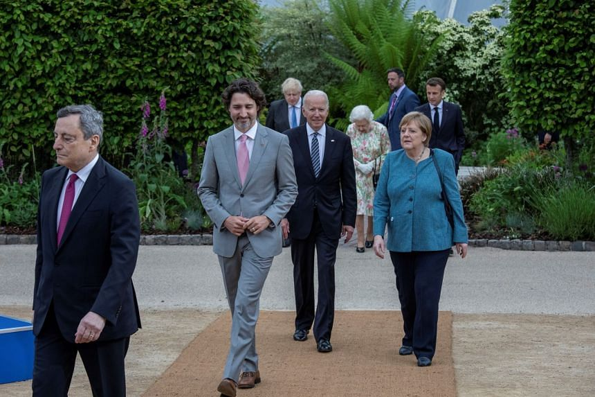 Joe Biden (centre) and Angela Merkel (right) join other G-7 leaders making their way to a reception with Britain's Queen Elizabeth II on the sidelines of the G-7 summit in England.
