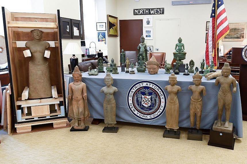 Antiquities for repatriation to Cambodia on display on Wednesday at the Manhattan District Attorney's Office in New York. They include several Hindu and Angkorian Buddhist statues.