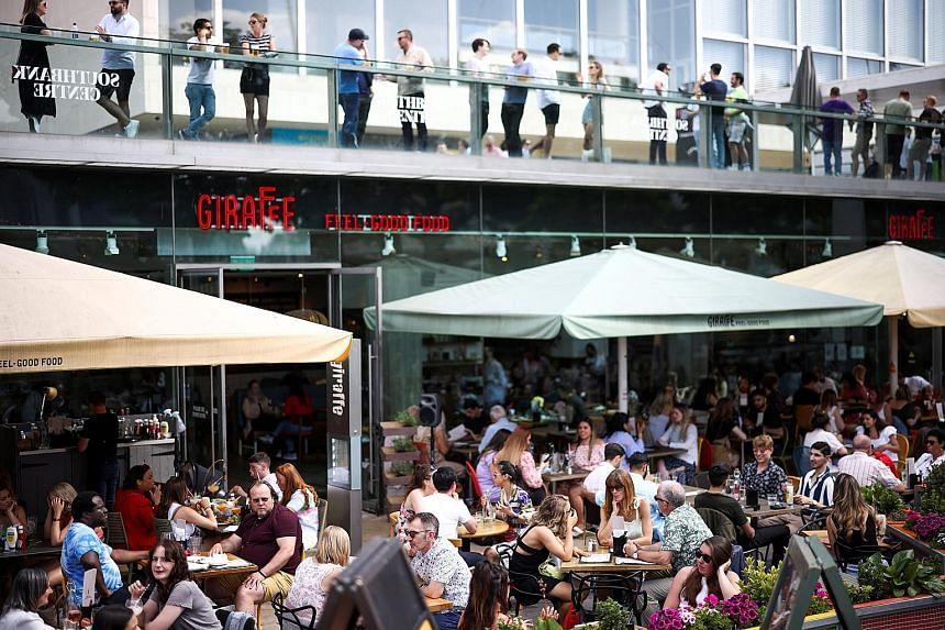 Diners at an outdoor restaurant on the South Bank in London last Saturday. The reopening of shops, hairdressers and restaurants serving outdoors after months of lockdown boosted the British economy in April. A rapid vaccination programme means Britai