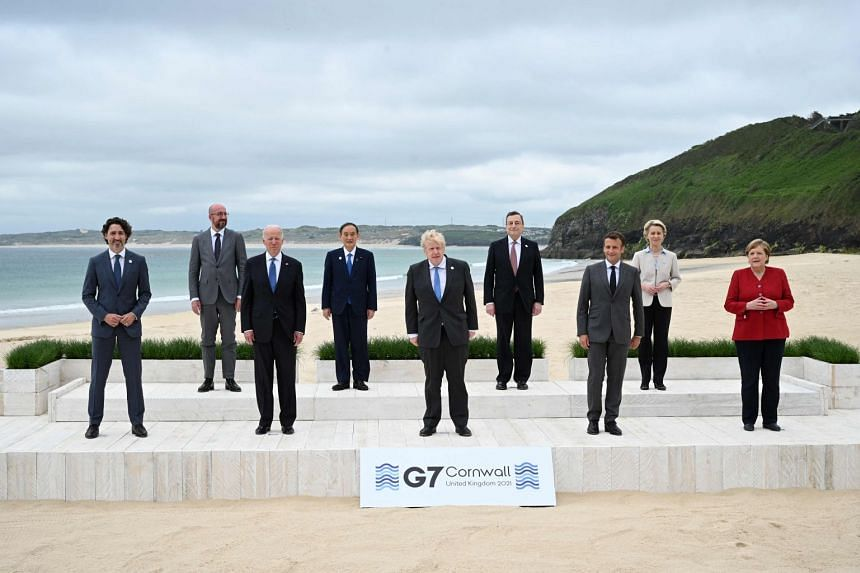 Leaders pose for the family photo at the start of the G-7 summit in Carbis Bay, Cornwall, England.