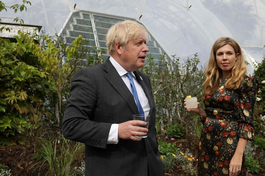 Britain's Prime Minister Boris Johnson (left) and wife Carrie Johnson arrive for the G-7 reception at The Eden Project in south west England.