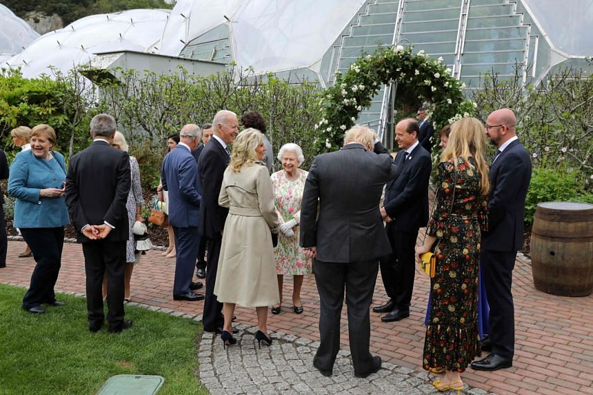 Britain's Queen Elizabeth II (centre) speaks with G-7 leaders during a reception at The Eden Project in south west England.