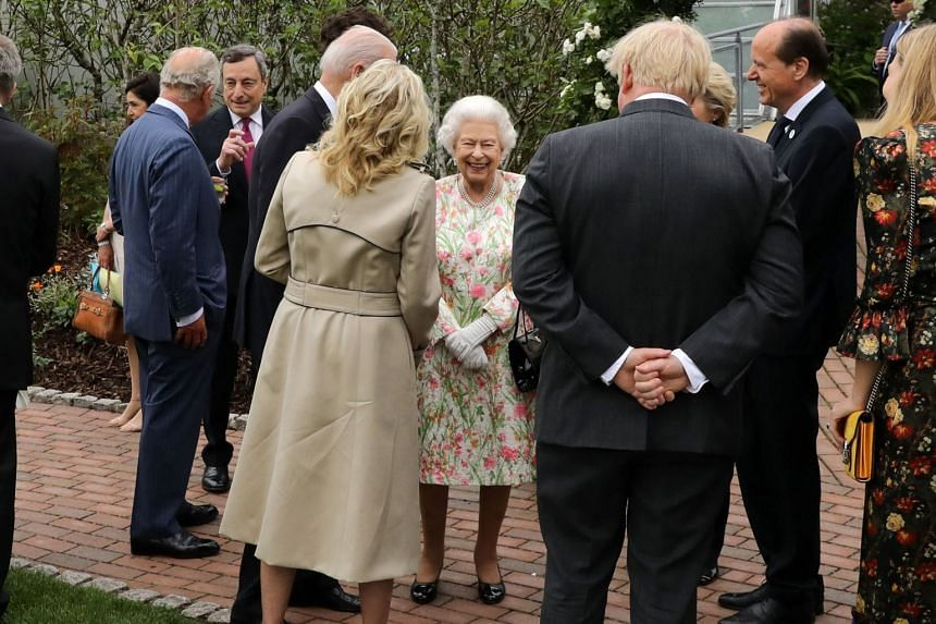 Britain's Queen Elizabeth II (centre) speaks with leaders of the G-7 during a reception at The Eden Project in south-west England.