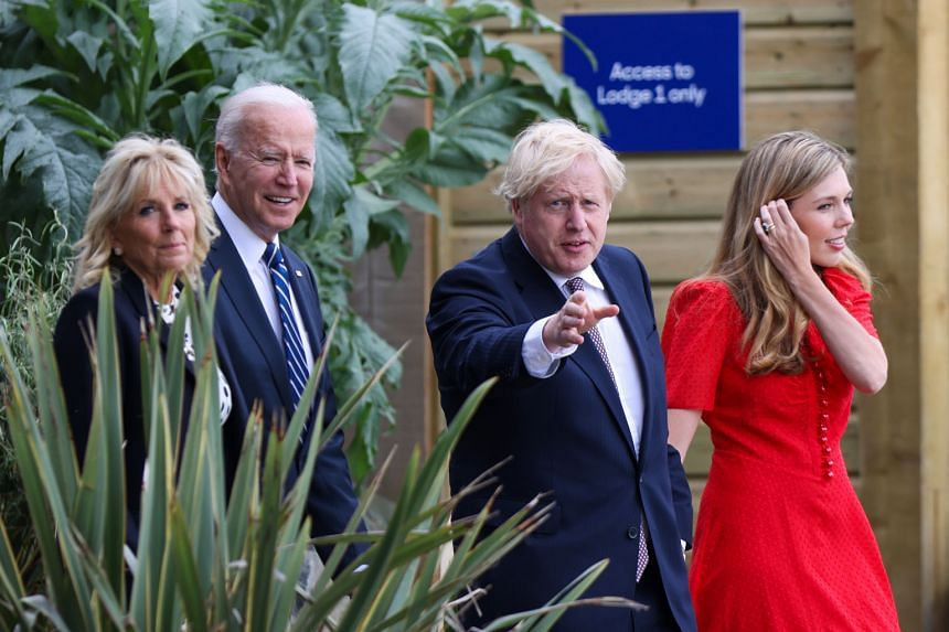 US President Joe Biden and his wife Jill with British Prime Minister Boris Johnson and his wife Carrie at the seaside resort of Carbis Bay in Cornwall, south-west England, on Thursday. Mr Biden, Mr Johnson and other Group of Seven leaders met at the