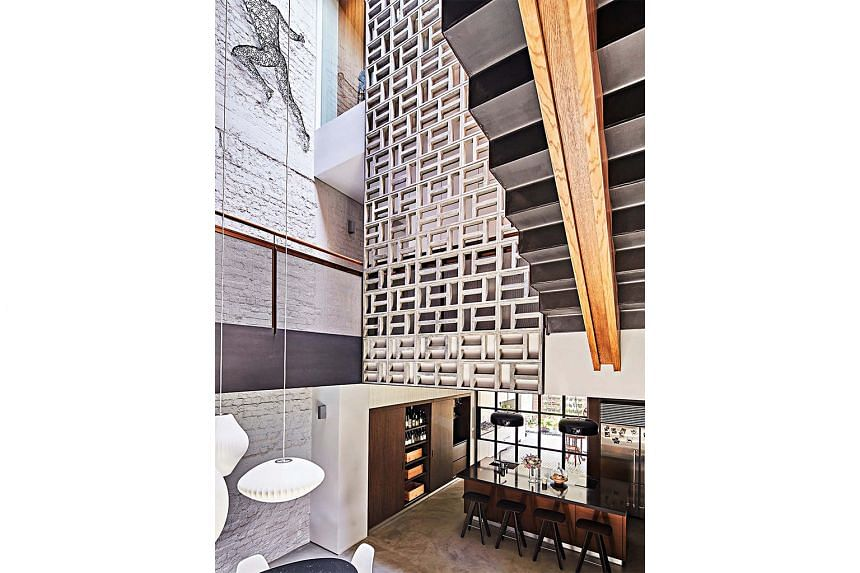 The atrium's standout feature is a screen of concrete vent blocks that stretches from the second to the third storey. Its design was inspired by the facade of a block of old walk-ups in the Joo Chiat area.