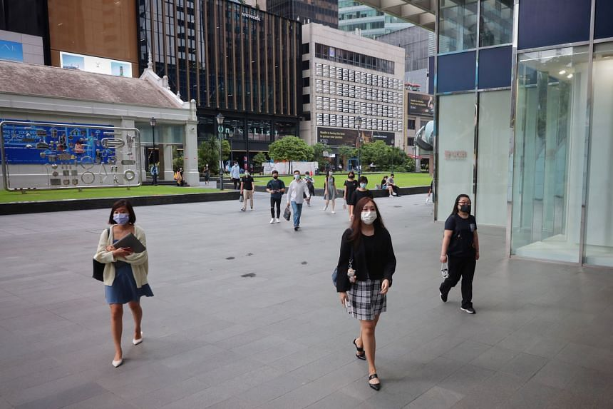 Office workers at Raffles Place on May 17, the second day of tightened Covid-19 measures in Singapore. Bosses should not use non-vaccination as a reason to terminate employment as there could be medical reasons for staff not getting a jab, said Insti