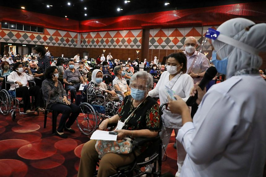 MALAYSIA: People waiting to receive their vaccine shots at an inoculation centre in Subang Jaya on April 26. Malaysia has set up mega vaccination centres that can inoculate up to 8,000 people a day.