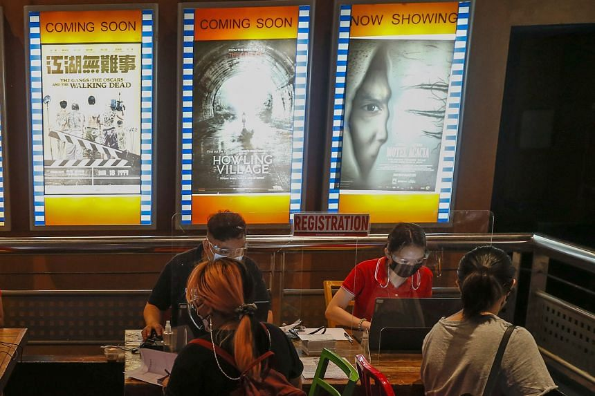 THE PHILIPPINES: Registration booths set up inside a cinema complex for citizens preparing to be vaccinated in San Juan City, Metro Manila, on June 1. Local government units are using alternative venues such as cinemas to boost vaccination campaigns