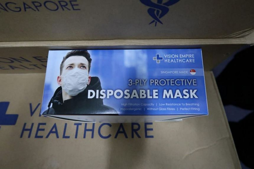 Vision Empire International is under investigation for manufacturing surgical masks without a licence at its Ubi Crescent facility (left) in an unhygienic and makeshift environment. The company is also suspected to have imported surgical masks from o
