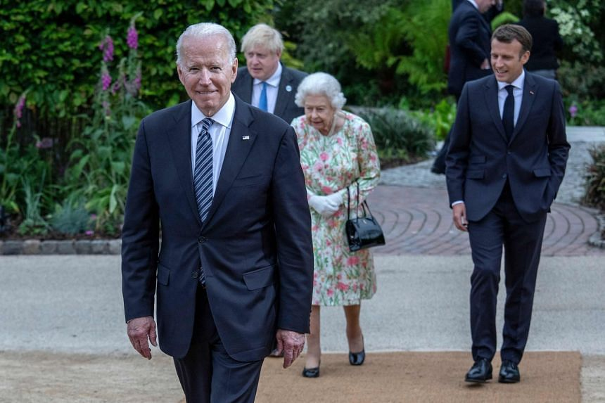(From left) Mr Joe Biden, Mr Boris Johnson, Queen Elizabeth II and Mr Emmanuel Macron arrive for a family phtotograph during a reception at The Eden Project in south west England, on June 11, 2021.
