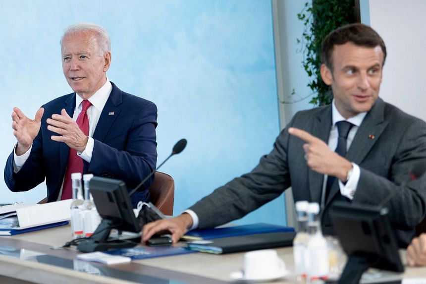 US President Joe Biden (left) and French President Emmanuel Macron attend a working session during the G-7 summit in Britain on June 12, 2021.