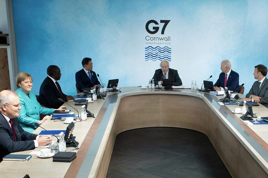Leaders attend a working session during the G-7 summit in Britain, on June 12, 2021.