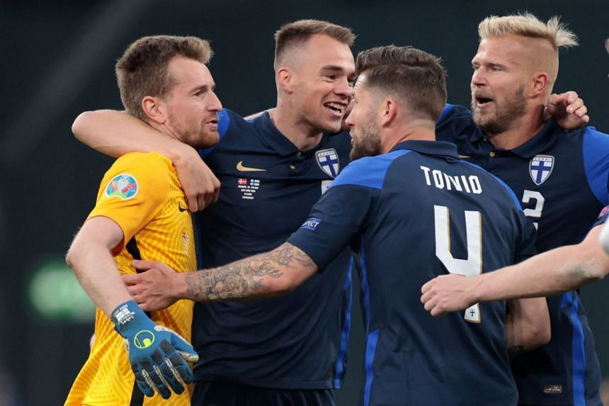Finland's Lukas Hradecky, Leo Vaisanen, Paulus Arajuuri and Joona Toivio celebrate after the match.