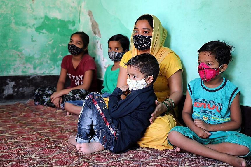 Mrs Anuradha Roy, who has been widowed, with her husband Kaushik and their children when they holidayed in February. When Mr Ravi Kumar, the sole breadwinner of his family, died on May 13 from Covid-19, he left behind his wife Sonia and their four ch