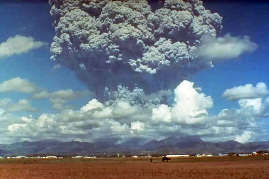 A massive cloud of steam and ash coming out of Mount Pinatubo in the Philippines on June 12, 1991.