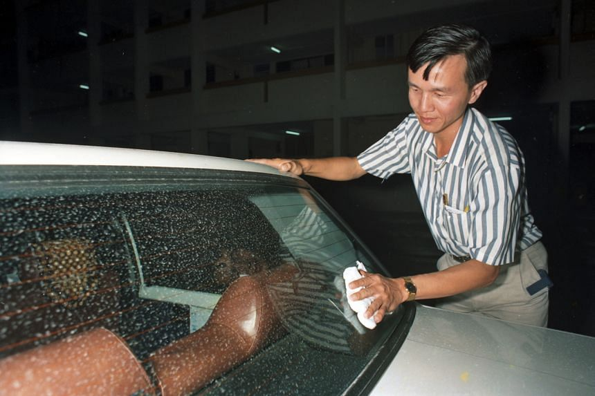 A car owner in Singapore wiping down his vehicle on June 17, 1991, after ash from the eruption of Mount Pinatubo in the Philippines was blown more than 2,400km to the Republic by high winds.