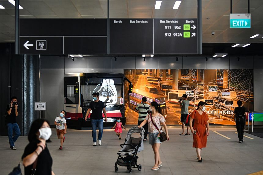 Commuters near the exhibition area at one end of the Woodlands Integrated Transport Hub opens on June 13, 2021.