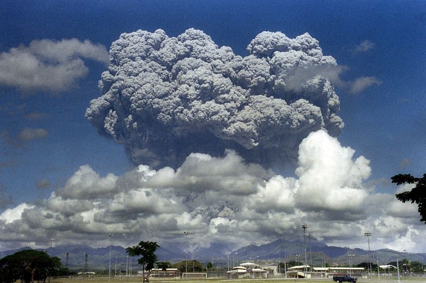 A giant mushroom cloud of steam and ash exploding out of Mount Pinatubo volcano in the Philippines on June 12, 1991.