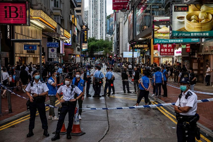 The Hong Kong police deployed 2,000 officers around the city on Saturday, reports the South China Morning Post.