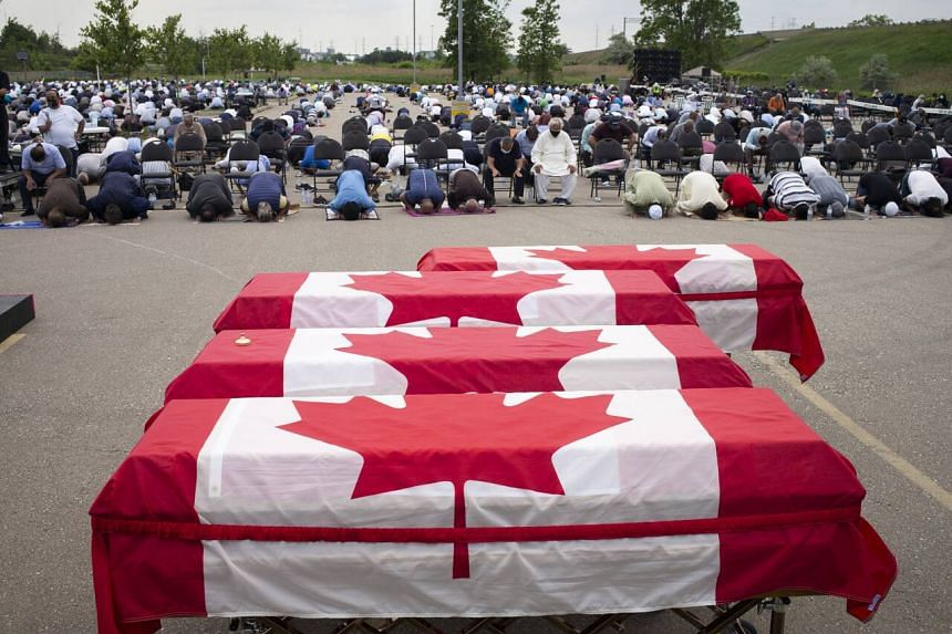 Mourners and supporters gather for a public funeral for members of the Afzaal family, in London, Ontario, on June 12, 2021.