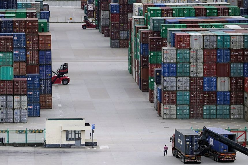Containers are seen at the Yangshan Deep-Water Port in Shanghai, on Oct 19, 2020.