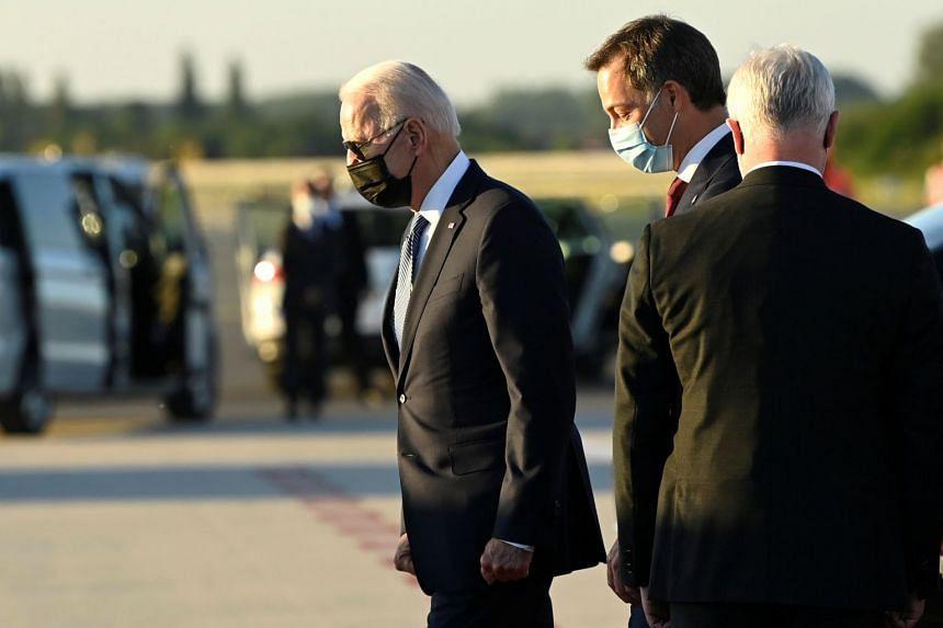 US President Joe Biden (left) is welcomed by Belgian PM Alexander De Croo ahead of a Nato summit, in Belgium, on June 13, 2021.