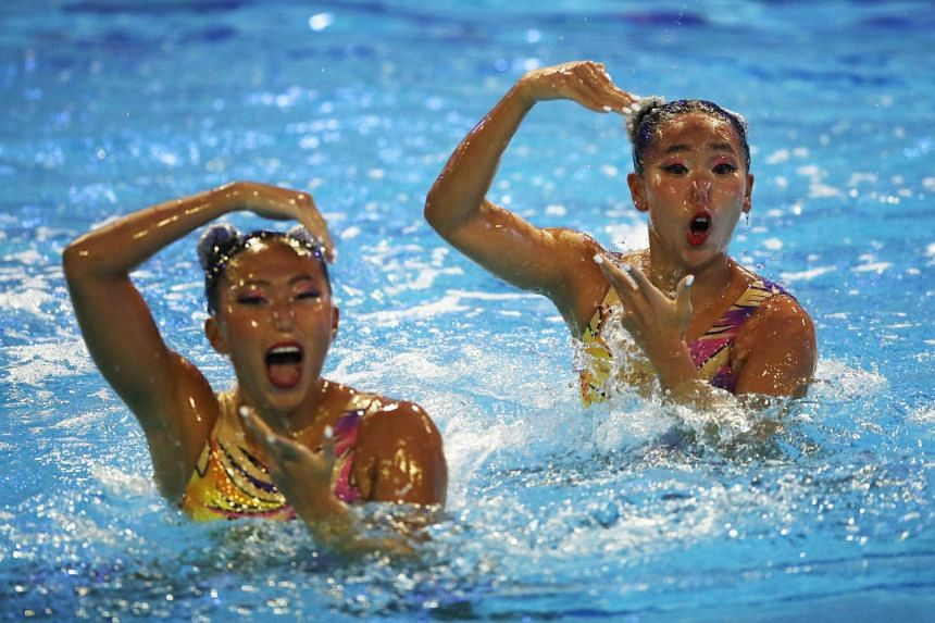 Singapore's Debbie Soh (left) and Miya Yong in action during their performance in Piscina Sant Jordi, Barcelona, on June 12, 2021.