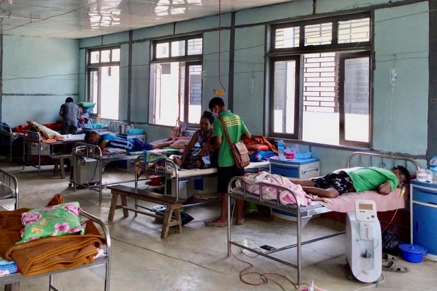 In this photo taken on May 28, 2021, Covid-19 patients receive treatment at a hospital in Cikha, Myanmar.