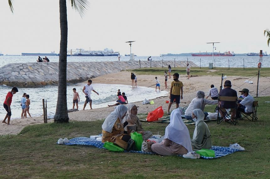 People gathering at East Coast Park on June 14, 2021. Groups of up to five people can gather socially again.