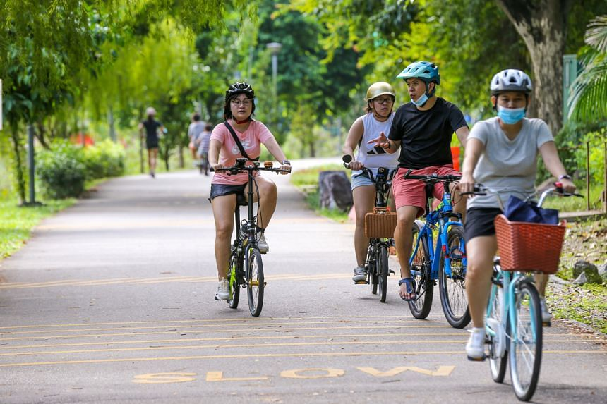 People cycling at Punggol Waterway Park on June 14, 2021.