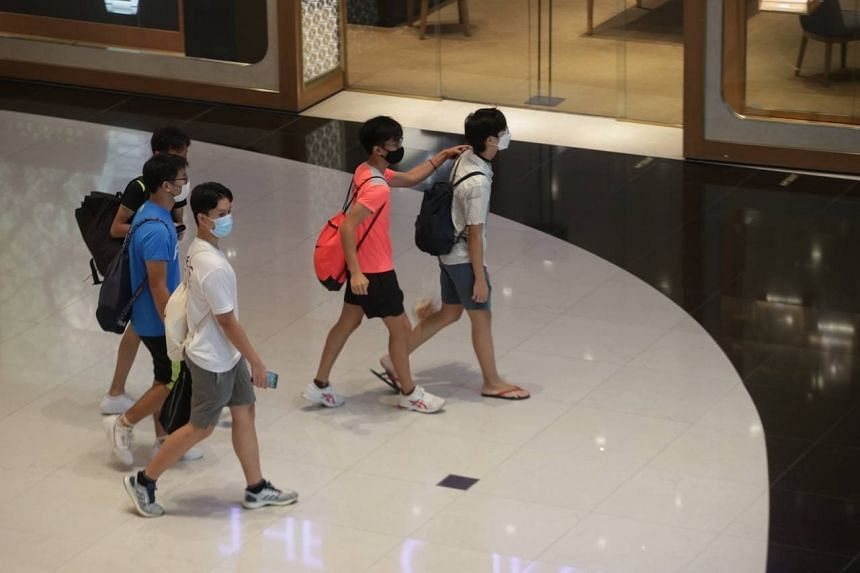 People at VivoCity on June 14, 2021. Groups of up to five people can gather socially again.
